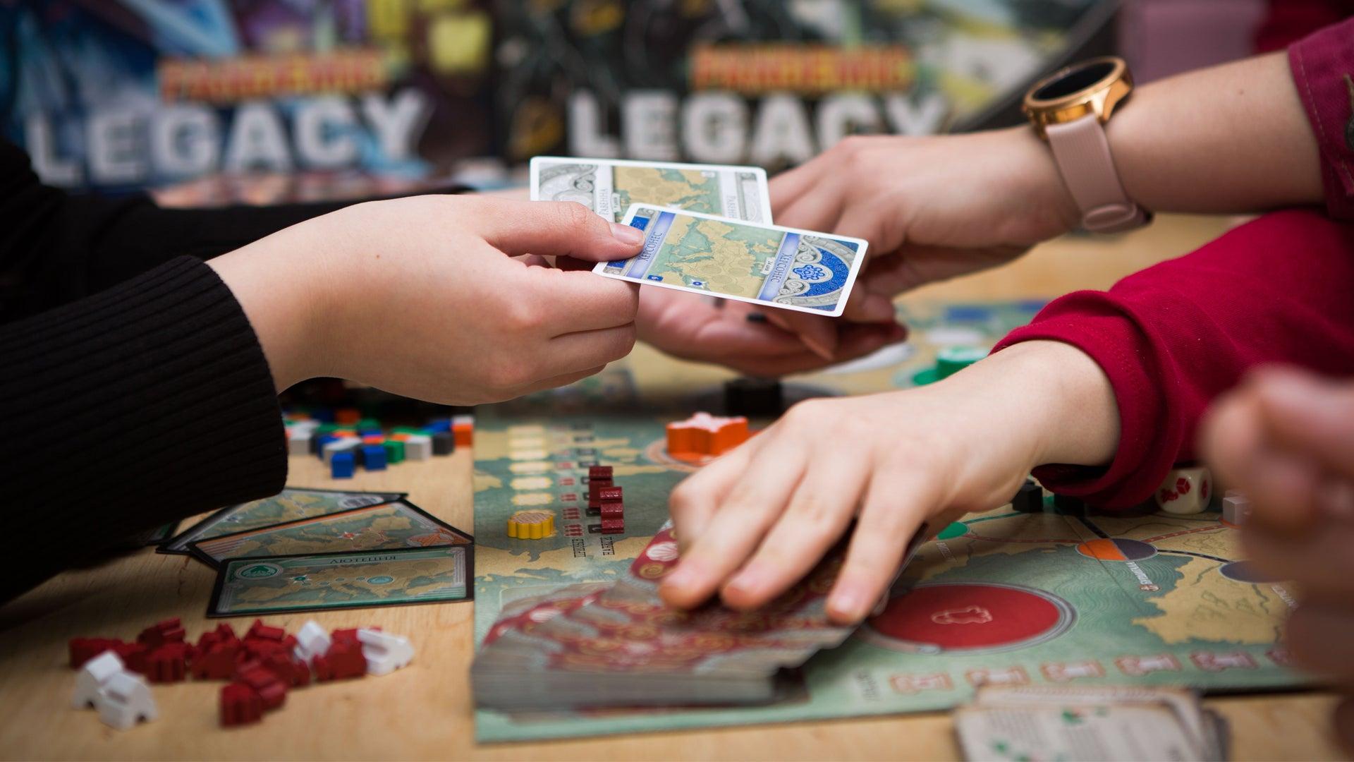 board-game-players-adobe.jpeg