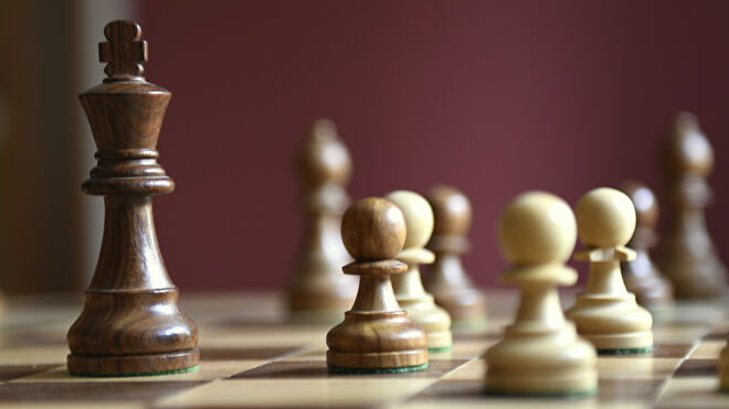 A chess king and pawn pieces