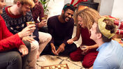 People playing board games at Christmas