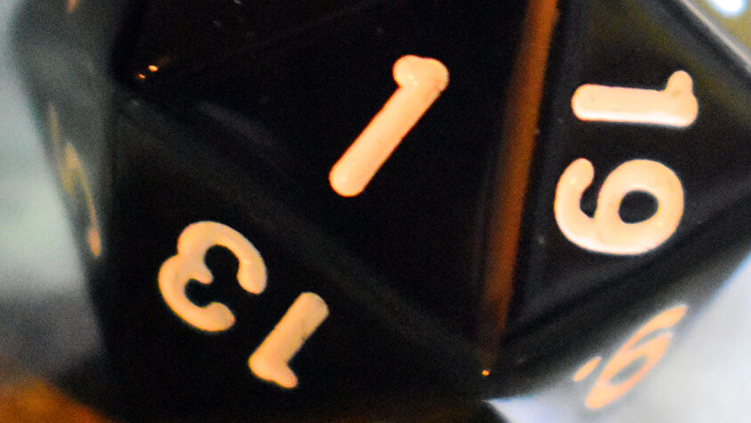 d20 20-sided die showing 1 result close-up