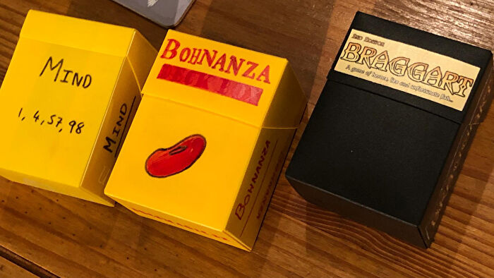 Board games in deck boxes