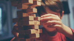 Image for 12-year-old stacks a Guinness World Record atop his precarious one-block Jenga tower