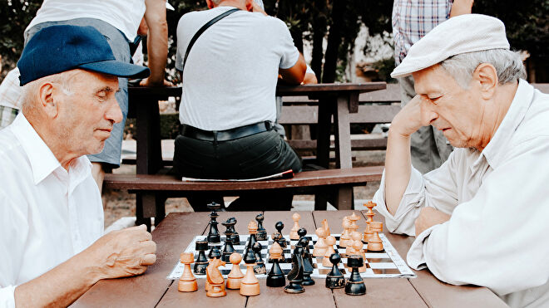 Two elderly men playing chess