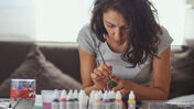 A woman painting miniatures