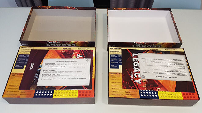 A counterfeit and real copy of board game Pandemic Legacy: Season 1 side-by-side