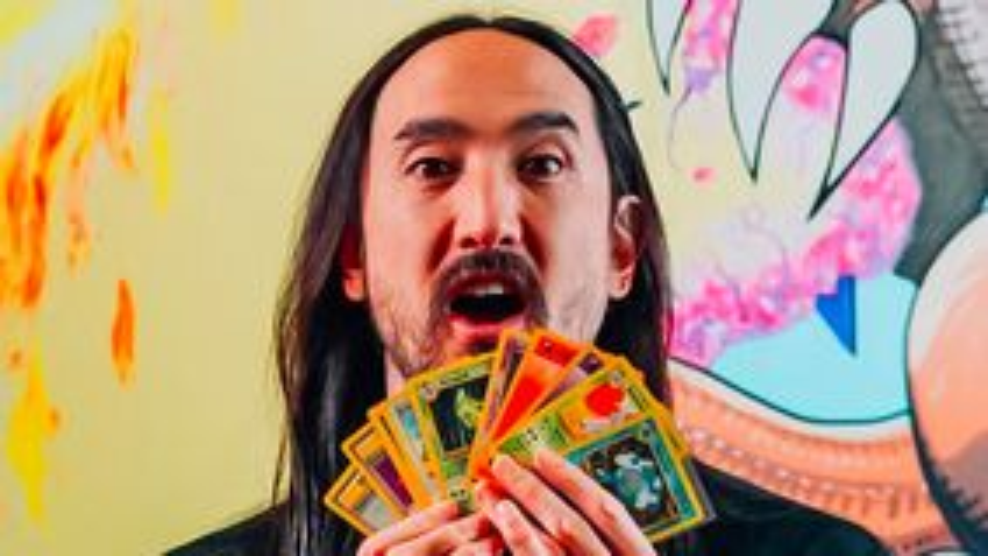 Steve Aoki holding Pokemon cards